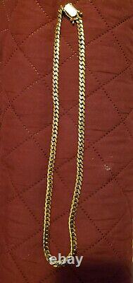 14k solid gold Miami Cuban chain 24 inches long 7mm wide 99.7 grams Heavy